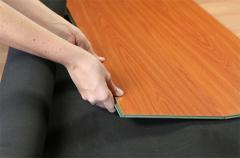 Base layers under laminated floors